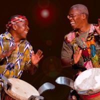 Two men playing drums