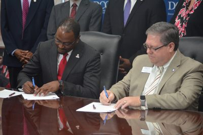 Dr. Anthony Graham and Dr. Darrin Hartness sign 2 +2 agreement.