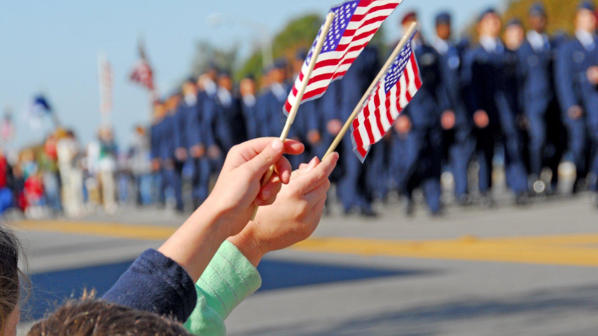 Handheld American Flags at Parade