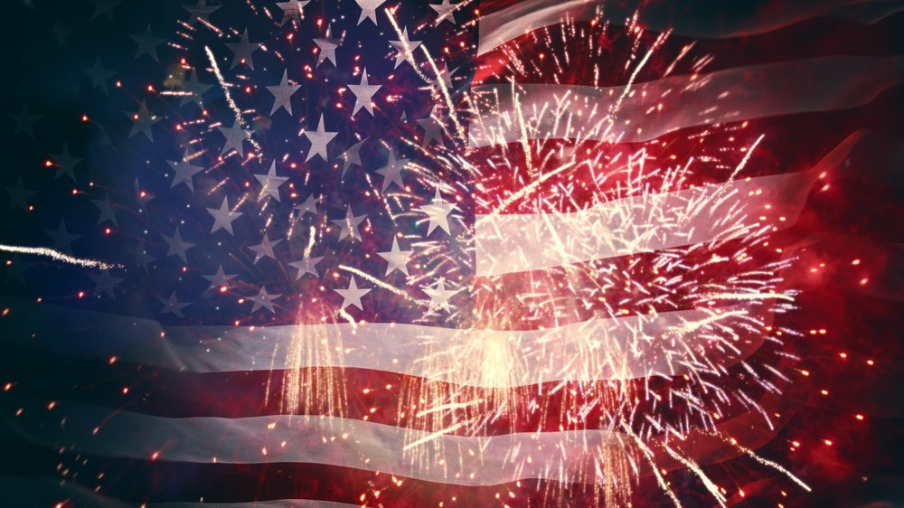 American Flag with Fireworks in foreground