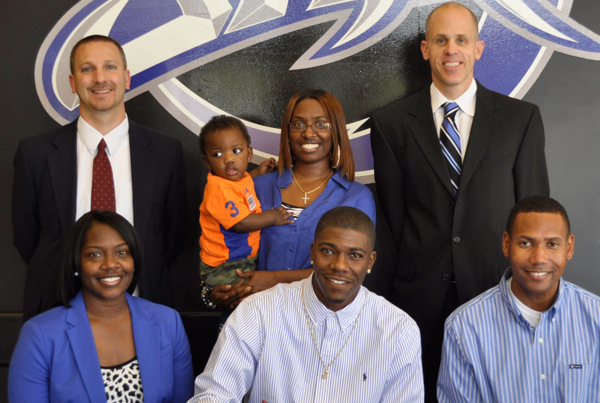 Basketball player, his family and coaches