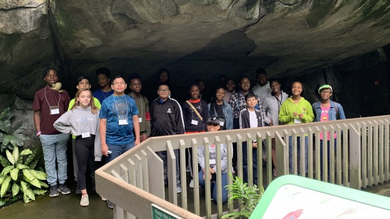 Group of TRIO Students in cave structure