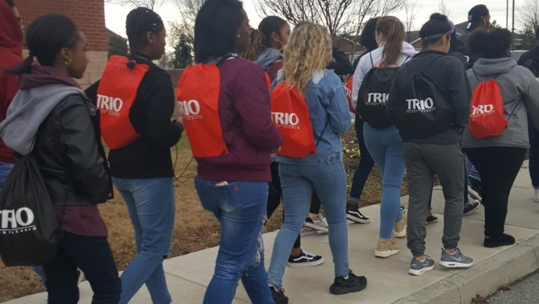 TRIO Students walks away with TRIO Book bags on