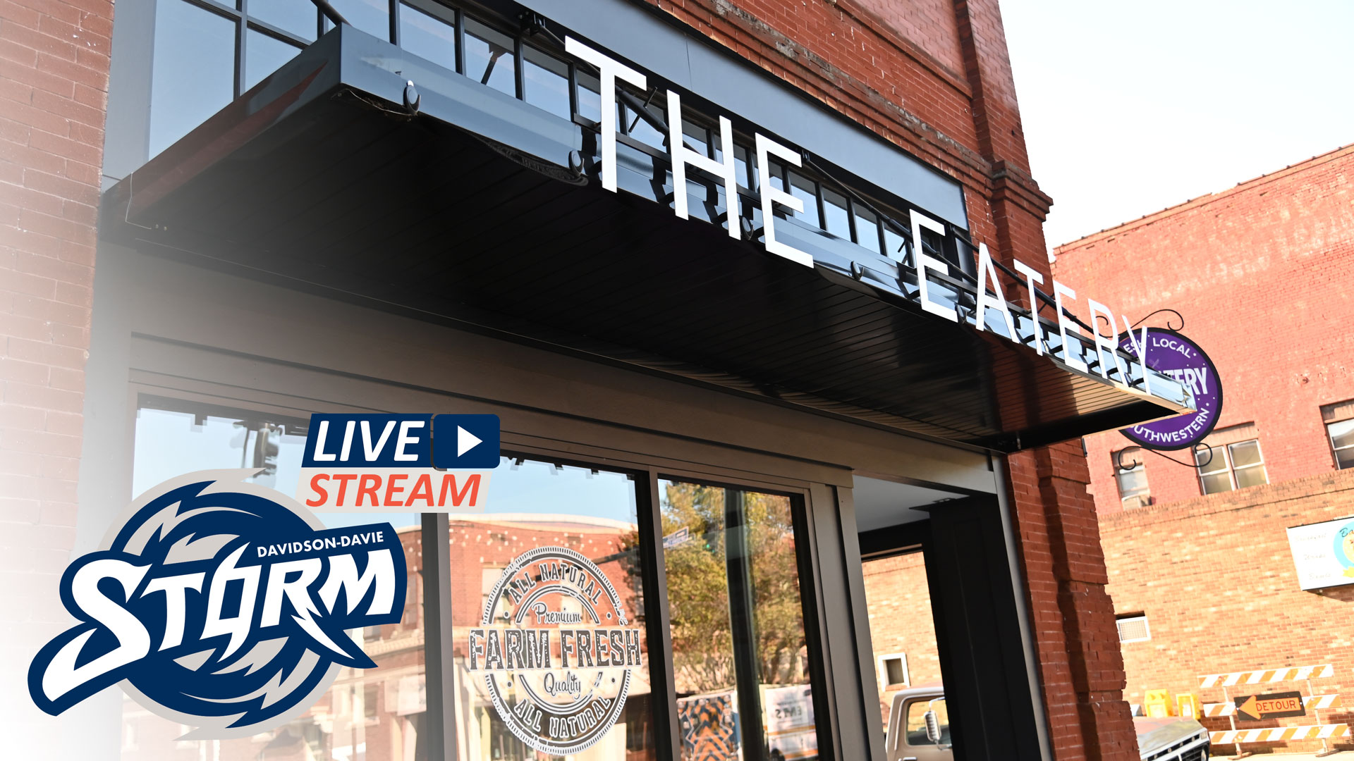 """Exterior of The Eatery restaurant. Storm Athletics logo. Text reads: """"Live Stream"""""""