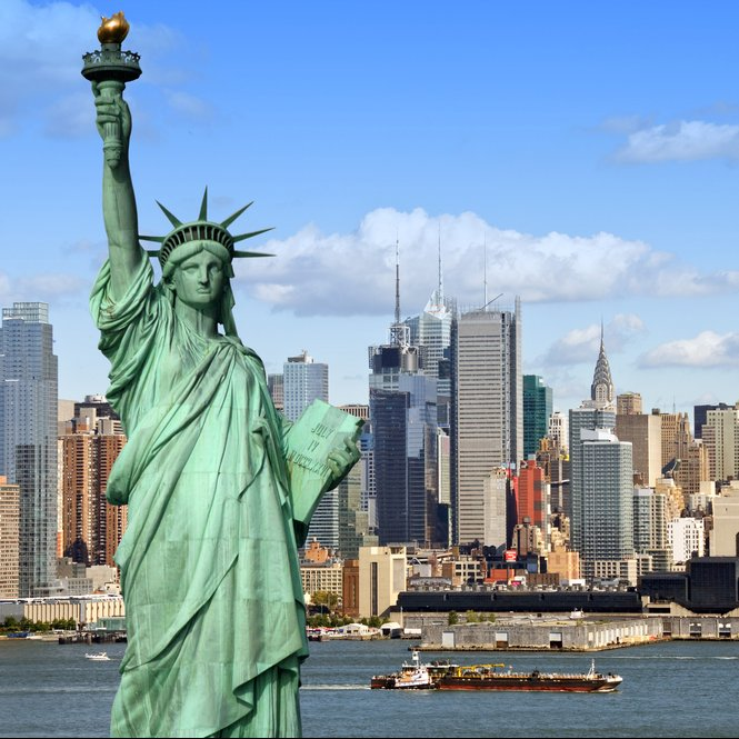 Statue of Liberty in front of New York Skyline