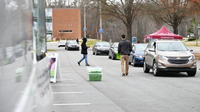 Cars lined up for free medicine giveaway event