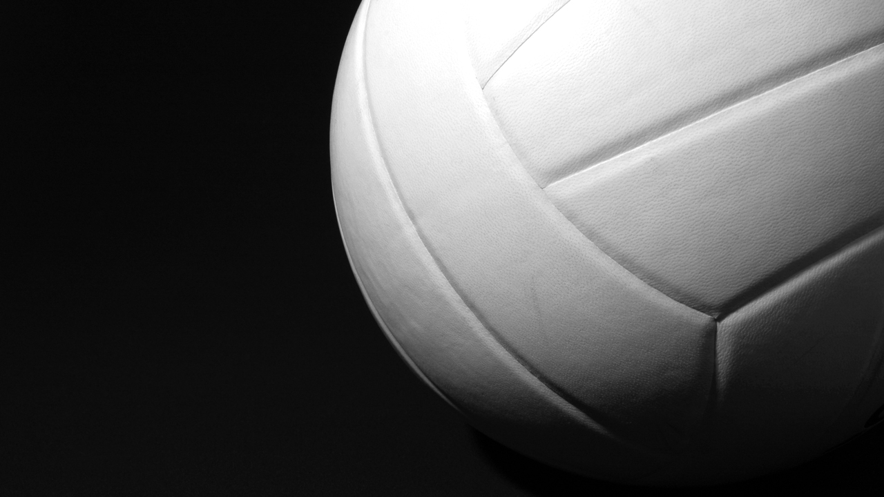 White Volleyball up close on black background