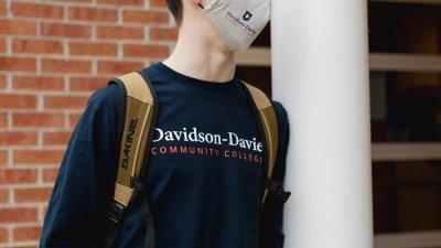 Close up on male student wearing Davidson-Davie Community College Shirt