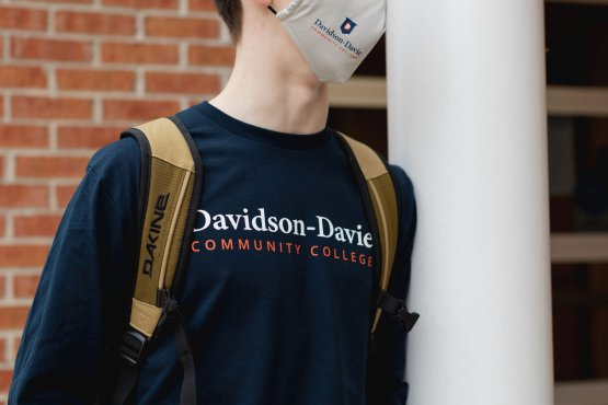 Close up on male student wearing Davidson-Davie Community College Shirt