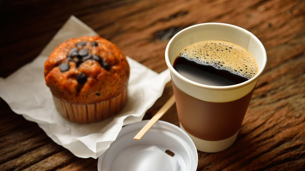 Coffee and muffin on table